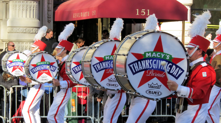 Drummers march in festive costumes during the 2012 Macy's Thanksgiving Day Parade.