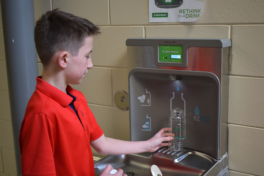 Boy filling waterbottle