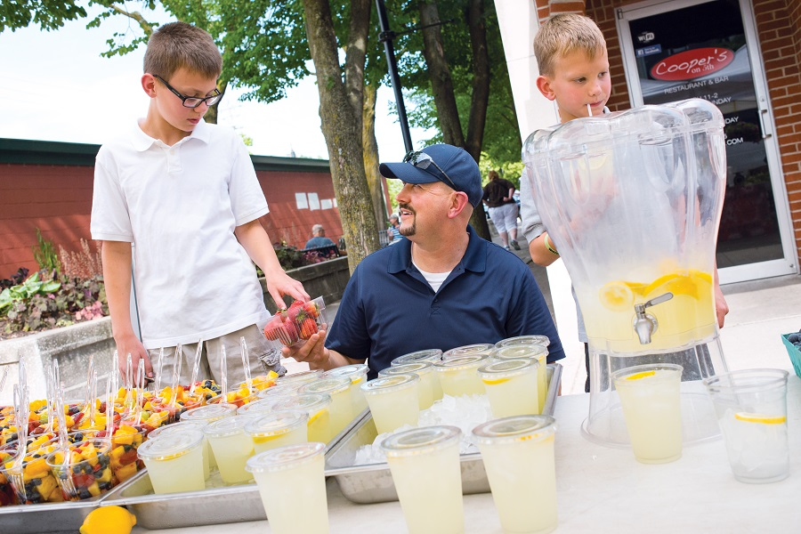 Dad and sons selling lemonade
