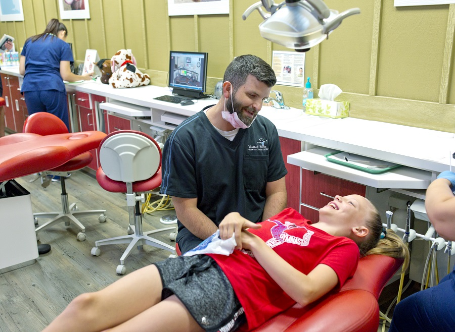 Dentist making kid laugh