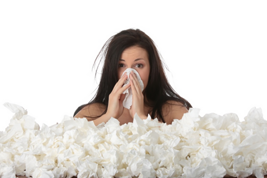 A woman with allergies and sinus pressure blows her nose dozens of times.